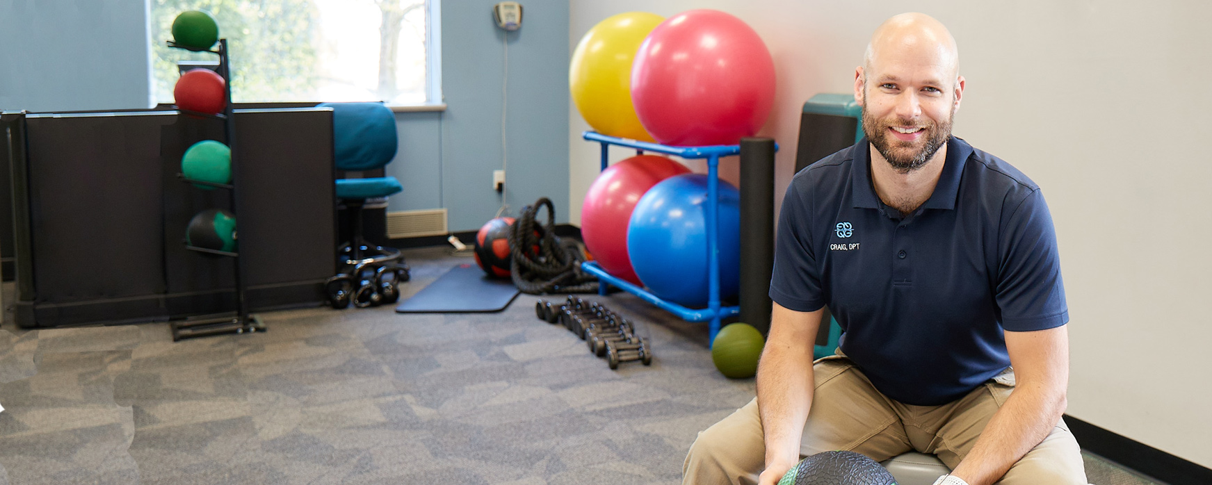 Physical Therapist sitting in quadmed fitness center