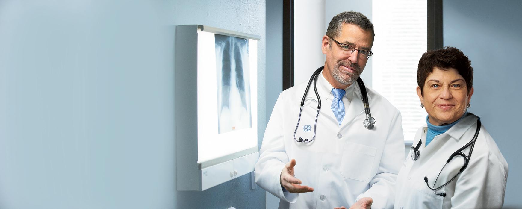 Doctors looking at radiology x-ray