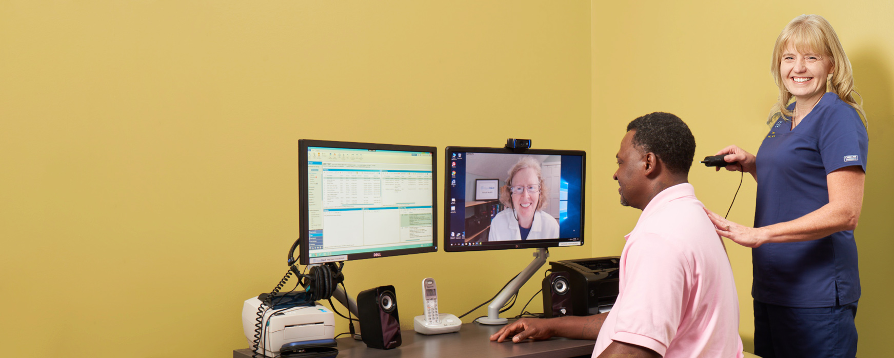 A patient visit with doctor and nurse in a QuadMed virtual health suite