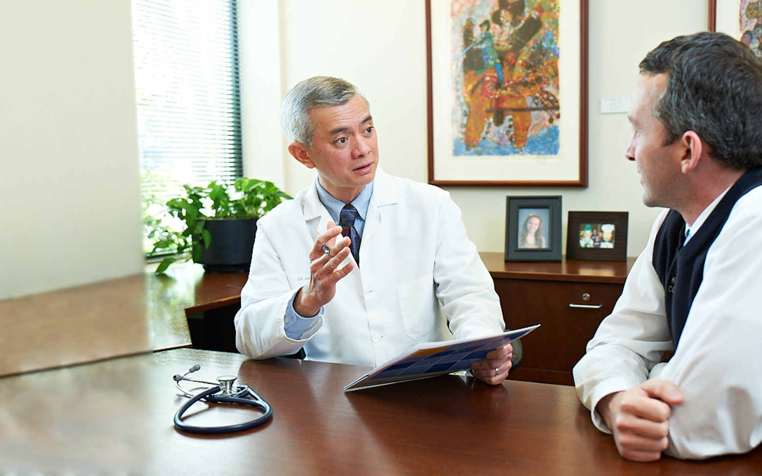 Doctor talking with a patient at a QuadMed onsite clinic