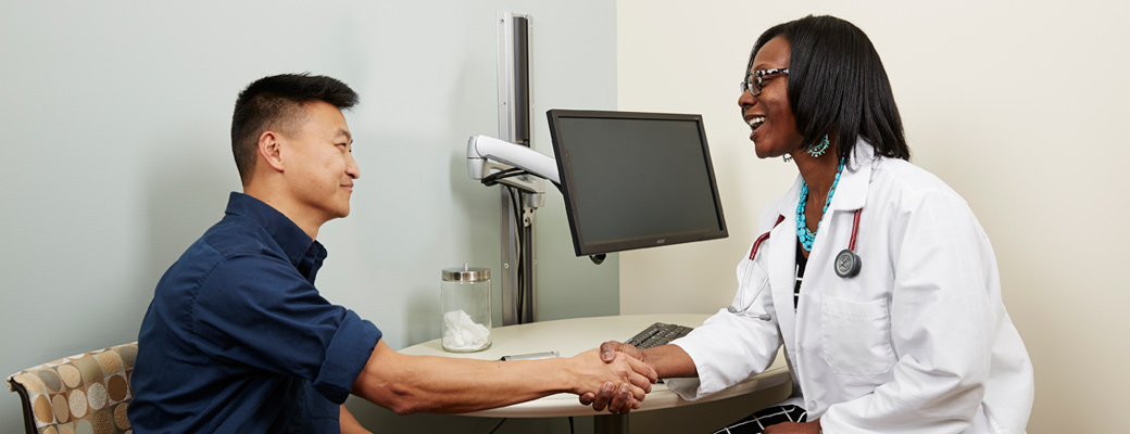 Patient shaking hands with doctor in an onsite health center