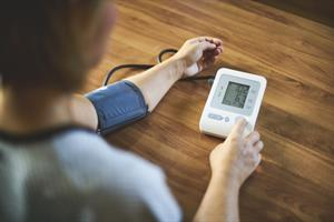 patient taking blood pressure at home